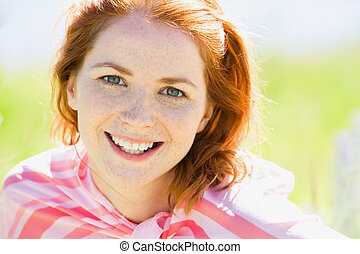 Young woman - Portrait of young woman with red hair looking...