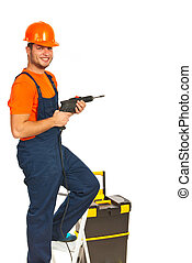 Repairman with drill - Happy repairman with drill on...