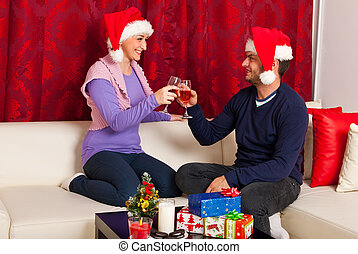 Christmas couple toasting with wine