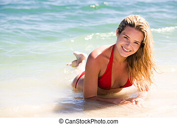Girl in the sea - Portrait of pretty girl in red swimsuit...