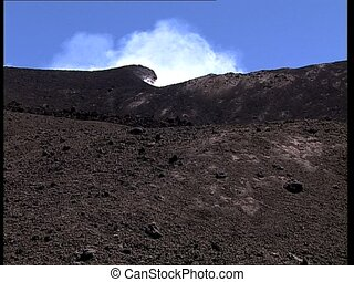 VOLCANO crater smoking zoom in