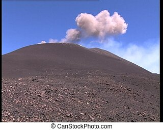 VOLCANO erupting dust clouds LS - View of a volcano Etna...