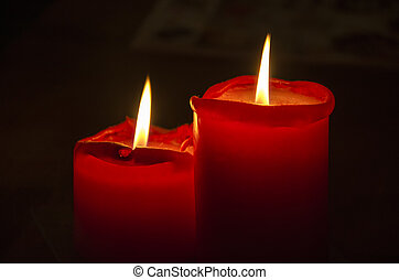 Red Christmas candle. - Red Christmas candles on a black...