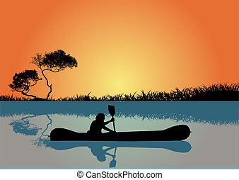 Man kayaking at sunset