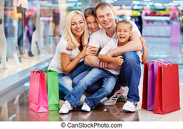 Family of shoppers - Portrait of joyful family with...