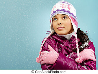 Cold weather - Pretty woman in warm jacket and knitted cap...