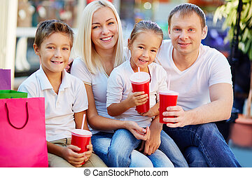 Refreshment - Portrait of joyful family having break and...