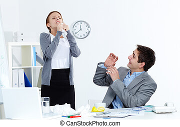 Sick colleague - Image of sick businesswoman sneezing while...