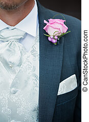 Formal wear - The groom dressed formally for the special...