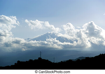 The little streak of white is Mount Etna, in fact (hardly visible). Sicily