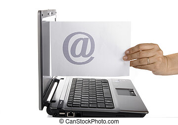 Women send email - The woman holding the white paper with an...