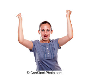 Happy woman screaming and celebrating a victory