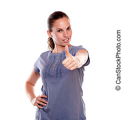 Positive young woman lifting the fingers up