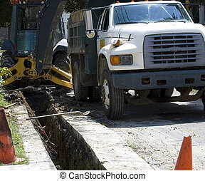 dump truck construction - dump truck and backhoe on...