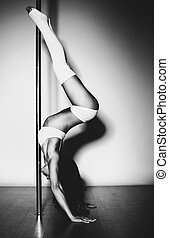Young slim woman - Young slim pole dance woman Black and...