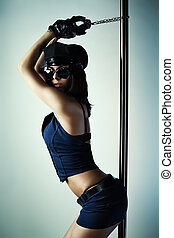 Young slim woman - Young slim pole dance woman in police...