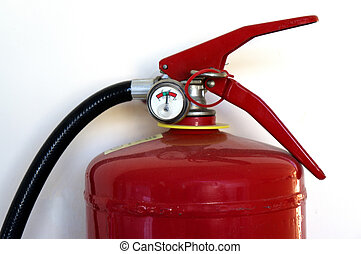 Fire extinguisher on a wall closeup