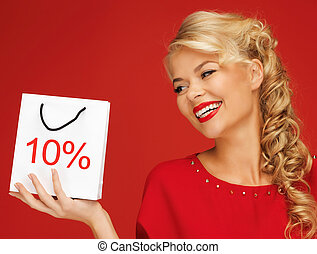 lovely woman in red dress with shopping bag - picture of...