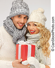 romantic couple in a sweaters with gift box - picture of...