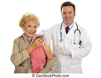 Flu Vaccination - Senior woman receiving flu vaccine from a...
