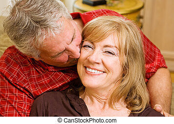 Lucky in Love - Beautiful mature woman getting a kiss from a...