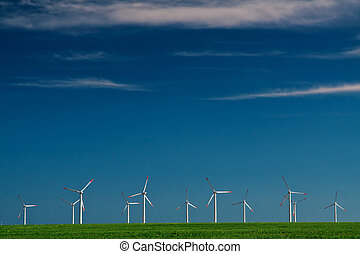 Wind power generators on blue sky