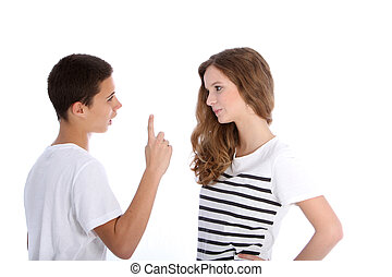 Two young teenagers arguing with the boy wagging his finger...