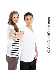 Teenage brother and sister giving a thumbs up - Three...