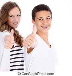Happy teenagers giving a thumbs up - A happy teenage boy and...