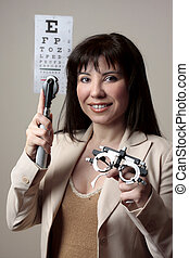 Eye doctor with equipment - Eye doctor with instruments for...
