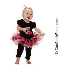 Dancing Baby in Tutu - A one year old baby dances isolated...