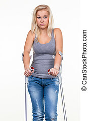 woman with crutches - a young woman with crutches symbolic...
