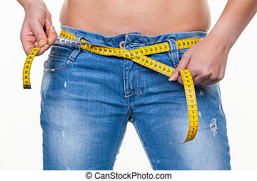 woman with tape measure before the next diet - a young woman...