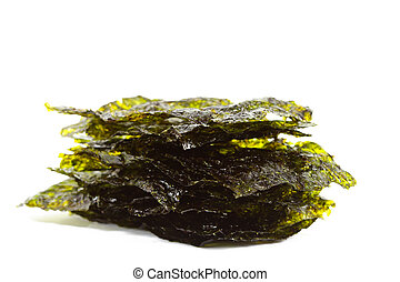 Isolated dark green sheets of a salted nori sea weed on the...