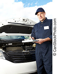 Professional auto mechanic. - Car mechanic working in auto...