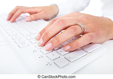 Hands with a computer keyboard Technology background