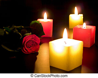 red rose with candles