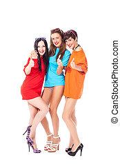 Three ladies making thumb gesture