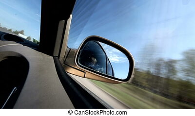 Day drive - Landscape in the sideview mirror of a speeding...