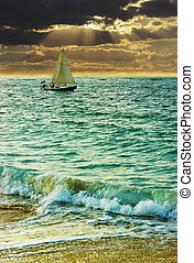 Sailing boat on a sunset