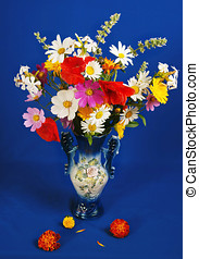 The luxuriant bouquet of various flowers on a dark blue...