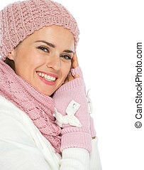 Portrait of smiling young woman in knit winter clothes