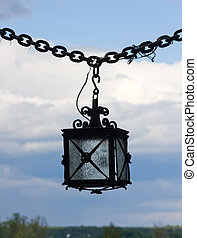 Old lantern in the castle on a sky background