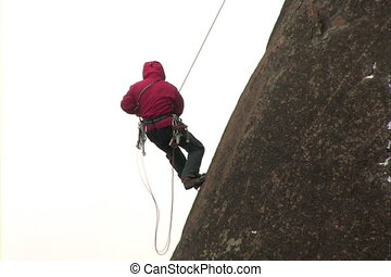 Rock climber - The Ascent of the climber on mountain