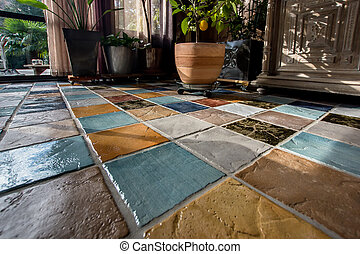 Colorful tile plunch on the floor in a living room
