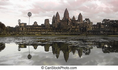 Sunset at Angkor wat - Sunset at Angkor Wat temple in...