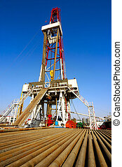 Drilling rig with drill pipe - A land drilling rig in...