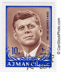 AJMAN - CIRCA 1970 : Stamp printed in Ajman shows John F...