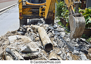 Backhoe digging Asbestos cement pipe. - to replace new...