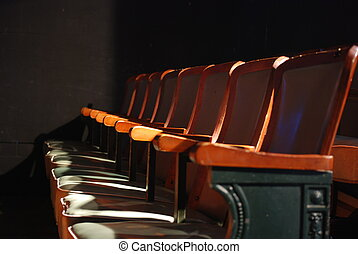 Theater Seats - Light hits a row of theater seats.